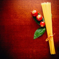 spaghetti with basil and cherry tomatoes, closeup
