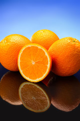 oranges on blue background