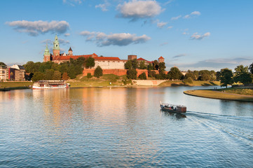 The boat on Vistula River near Wawel Royal Castle in Krakow