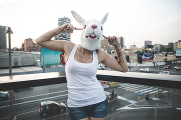 rabbit mask young beautiful long curly hair hipster woman