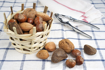 brazil nut, walnuts, almonds and hazelnuts in a basket