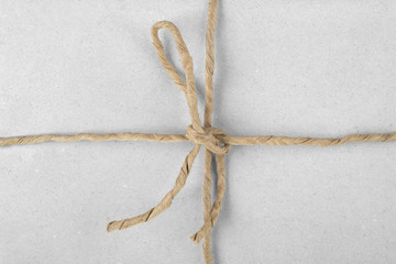 String tied in a bow on a packaging paper