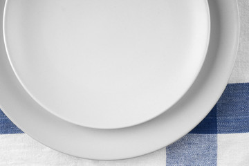 Empty plates at classic checkered tablecloth