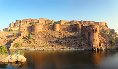 fort and lake in Jodhpur India at sunset