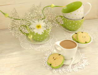 Bouquet of white flowers, cup cocoa, apple shaped cookies