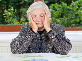 Unhappy elderly woman