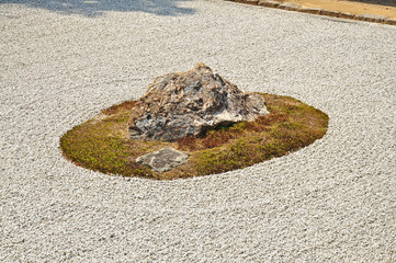 Zen rock garden at Ryoanji temple in Kyoto, Japan.
