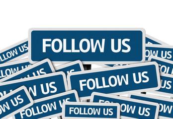 Follow Us written on multiple blue road sign
