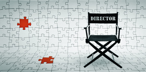 Director chair on jigsaw puzzle background