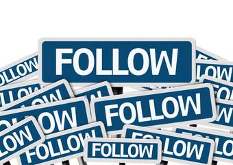 Follow written on multiple blue road sign