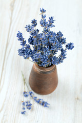dried lavender in a miniature clay vase
