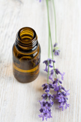 lavender essential oil on wooden surface