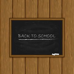 Black chalkboard on wooden background