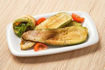 Fried zucchini with tomatoes