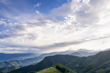 Mountain landscape with sky and clouds wideangle