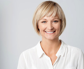 Smiling middle aged lady, studio shot