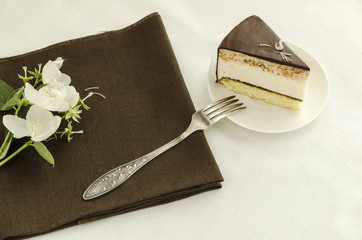 Piece of cake, decorated with jasmine flower