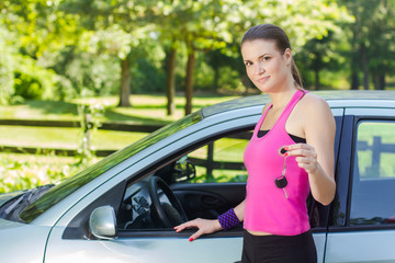 woman showing keys of new car