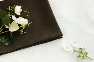 Flowers and jasmine petals on a linen napkin