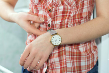 Girl clasps Wristwatch