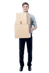 Young man holding cardboard boxes