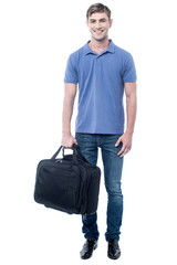 Smiling casual man standing with bag