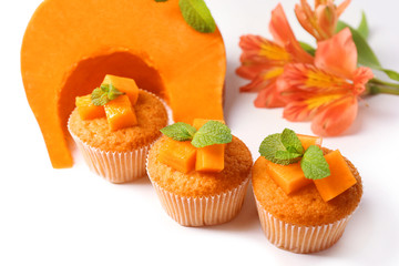 Tasty pumpkin muffins, isolated on white