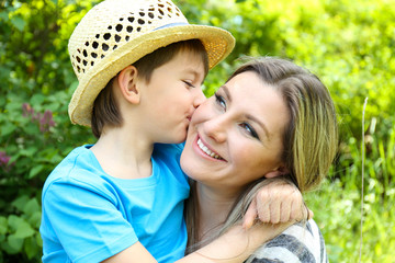 Happy mom and son in the park
