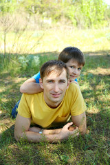 Happy dad and son in the park
