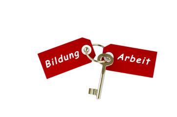 """Schlüssel """"Bildung und Arbeit"""" vor weißem Hintergrund"""