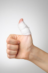 Injured thumb with bandage