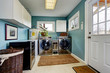 Laundry room with modern steel appliances - 68094416
