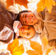 underneath view of young couple holding autumn leaves
