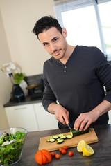 handsome young man kitchen organic vegetables salad summer