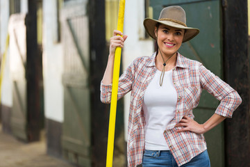 pretty cowgirl holding pitch fork