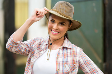 cowgirl holding hat