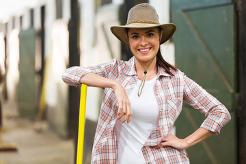 beautiful cowgirl inside stables