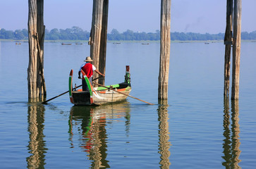 Local man in a boat near U Bein Bridge, Amarapura, Myanmar