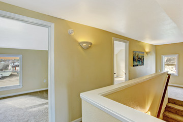 Hallway in empty house with staircase