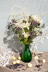 thistle and lily still life bouquet