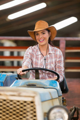 cowgirl driving tractor