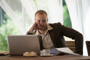 Businessman working cafe laptop