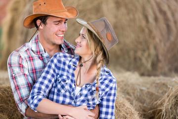 loving american western couple in barn
