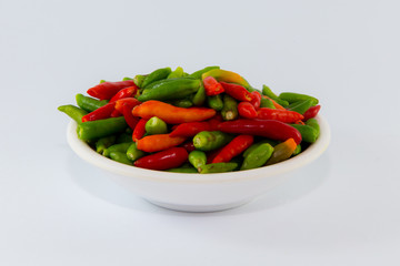 Small multiple color chilies on dish