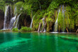 Waterfall and lake at Plitvice Lakes, Croatia.