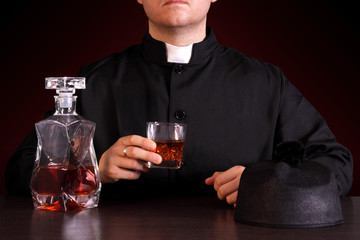 priest drinking alcohol