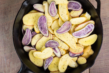 Blue and white potatoes frying