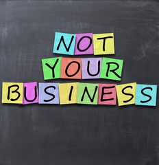 Not your business text on a blackboard