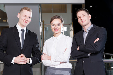 Business team standing with arms crossed