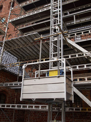 Scaffolds on a house building under renovations